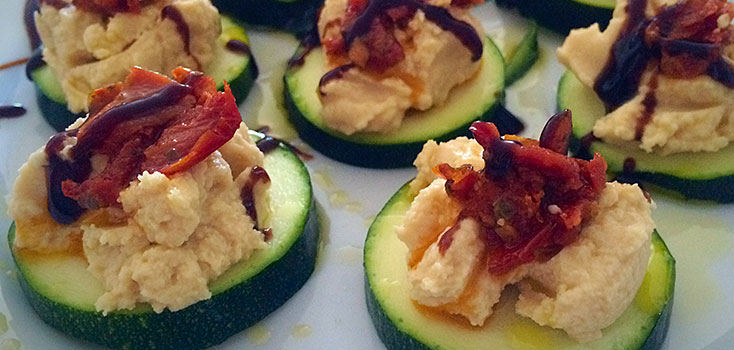 Zuchinni Slices Topped with Hummus